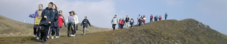 Pupils on a National Trust led guided walk near Carding Mill Valley